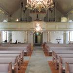 Väggar mot rum under läktare, Skrea kyrka
